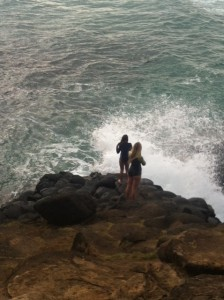 Two young women climbed down onto the rocks to take photos of each other. i held my breath, watching and waiting for the plumes of water to hit, preparing my rescue plan.