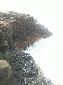 The sea below the lighthouse was punishing. Surf pummelled cliffs into small boulders.