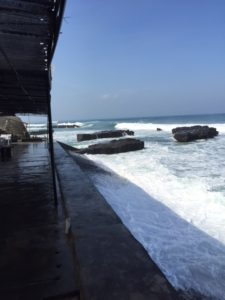 Crazy high king tides were wreaking havoc with the little beach cafes.